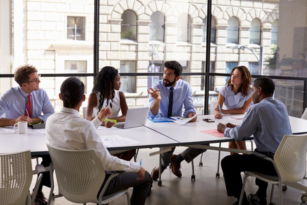 Employees discussing in the meeting room