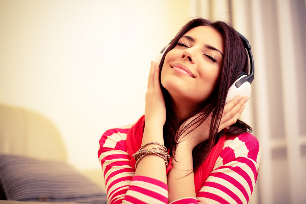 A young lady enjoying her headphone's music