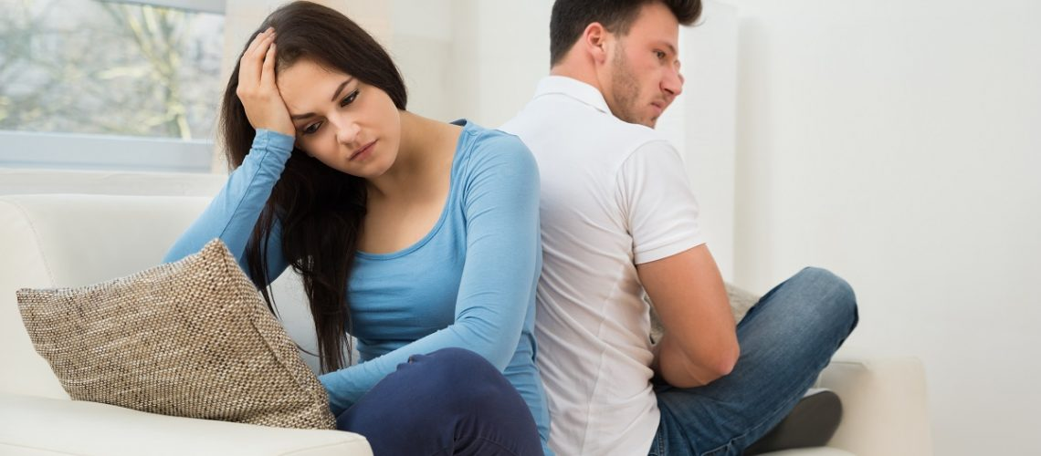 Frustrated couple sitting back-to-back