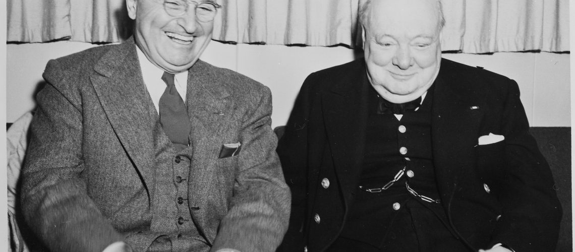 Photograph_of_President_Truman_sharing_a_laugh_with_British_Prime_Minister_Winston_Churchill_aboard_the_President's..._-_NARA_-_199016